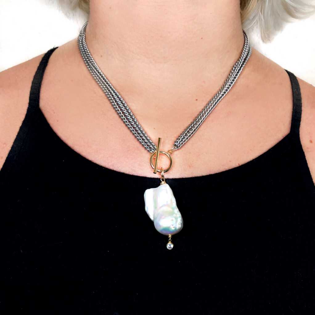 Example image of a view of a necklace being worn to show scale and size.